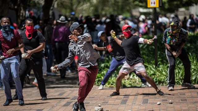 Police in South Africa use tear gas, water canon to disperse student protesters in Pretoria