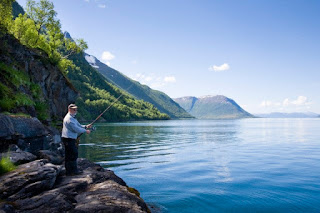 Man fishing in the fiord, Gratangen, Norway