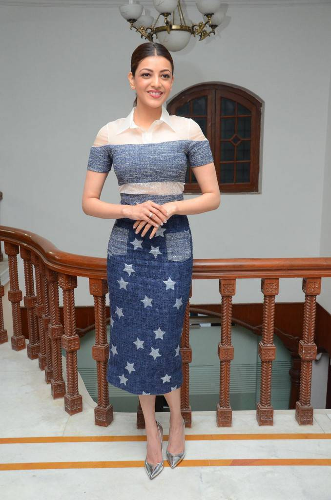 Actress Kajal Aggarwal In Blue Dress At Movie Interview