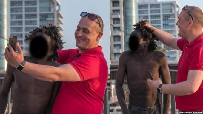 Israelí humilla a dos migrantes africanos en Tel Aviv| FOTOS