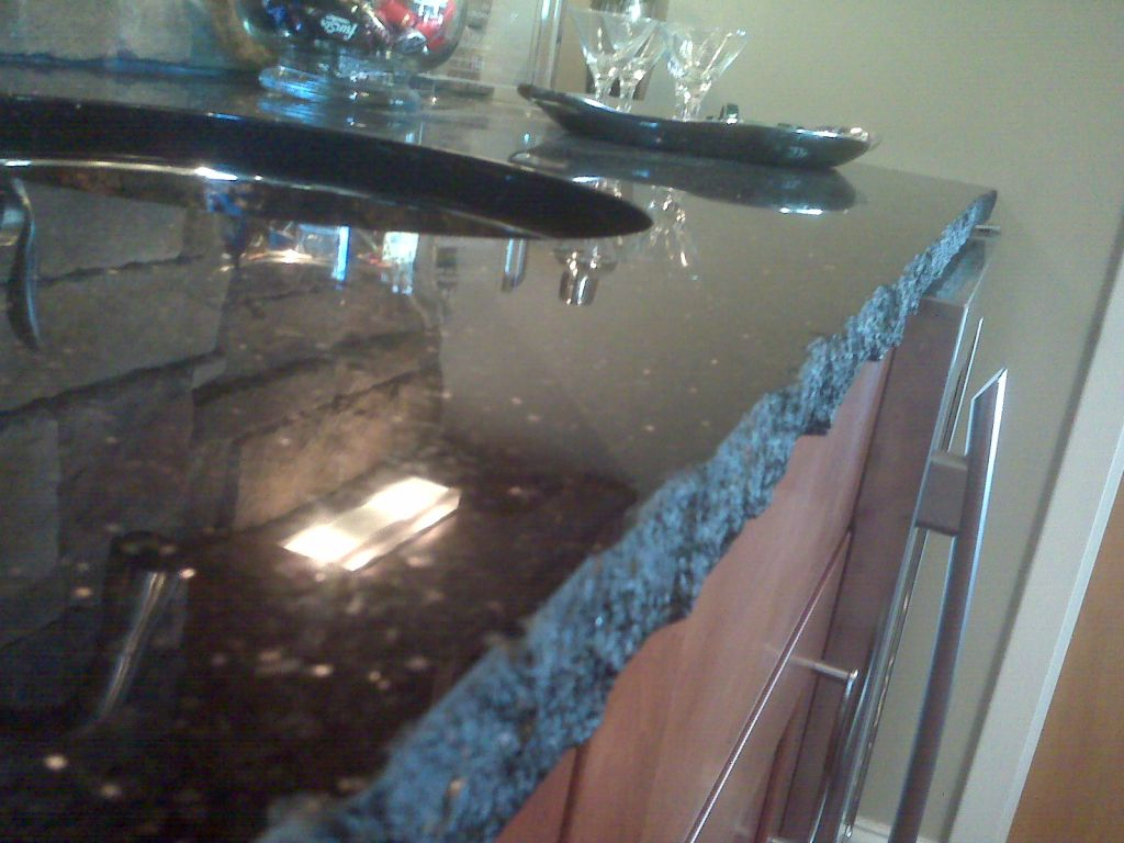 Chiseling The Edges Off Granite Slab With A Tool Or Machine This Creates Ragged But Also Sufficiently Uniform Edge That Looks Natural Is Safe