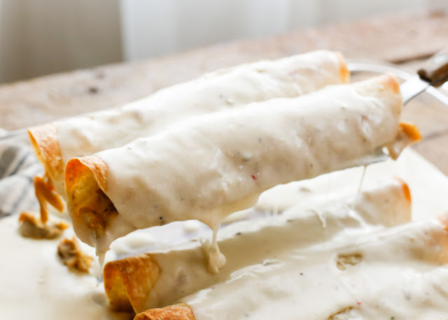 Slow Cooker Smothered Chicken Burritos - get the recipe at barefeetinthekitchen.com