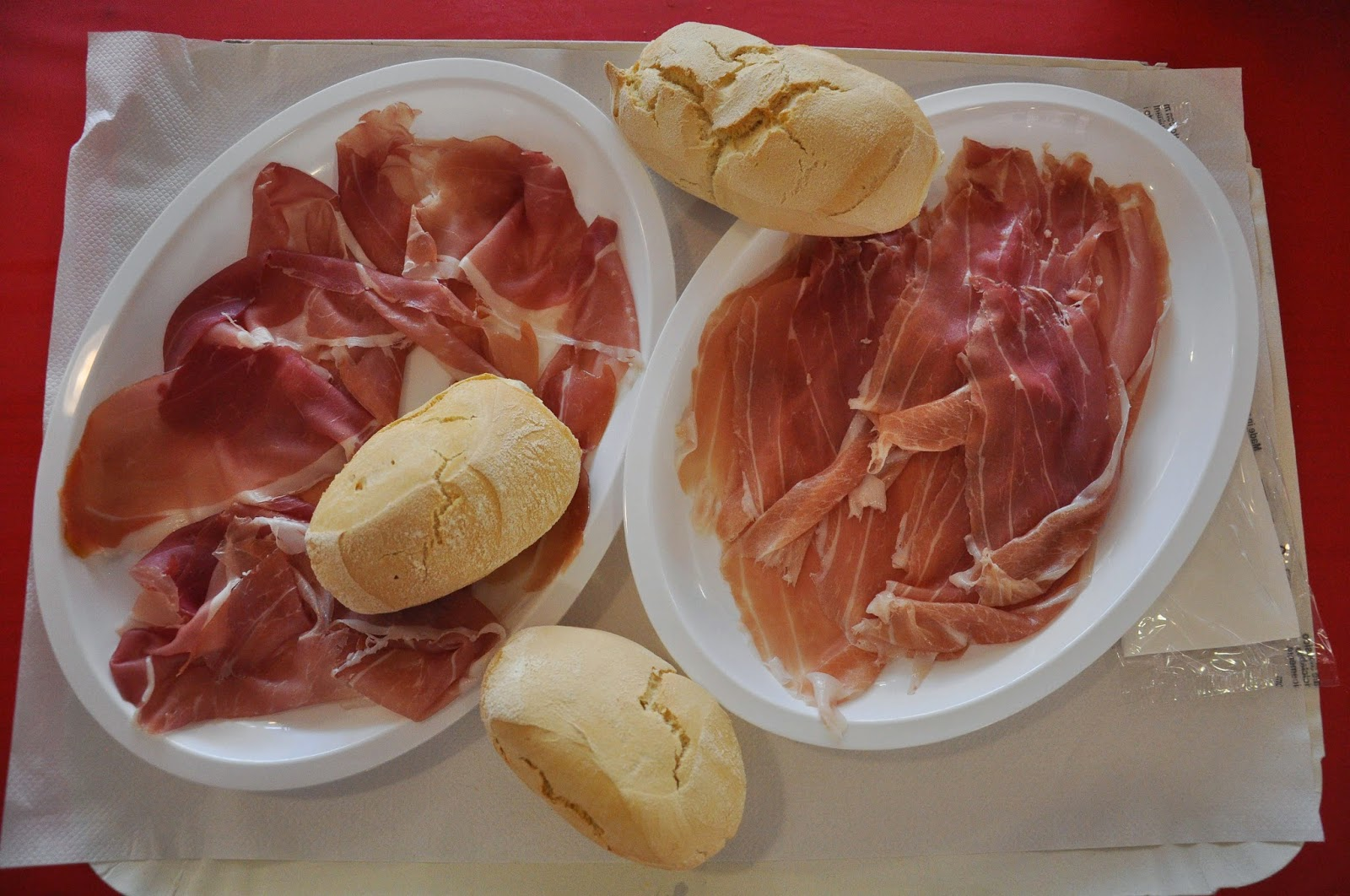 Plates with prosciutto in the prosciutto marquee in Montagnana, Veneto, Italy