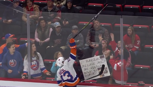 Matt Barzal gives stick to fan