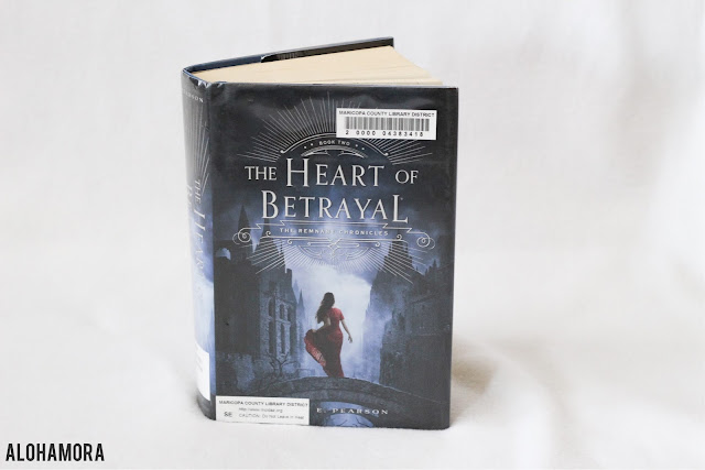 """The Heart of Betrayal by Mary E. Pearson is book two in the Remnant Chronicles trilogy.  The second book in this series is a fun addition, with Lia living in enemy territory, Venda.  She is thought to have """"The Gift"""" and the people of Venda quickly connect with Lia. book series, fun reads, teen, high school, adults, clean read, 8th, 9th, 10th, 11th, 12th.  Alohamora Open a Book alohamoraopenabook http://alohamoraopenabook.blogspot.com"""