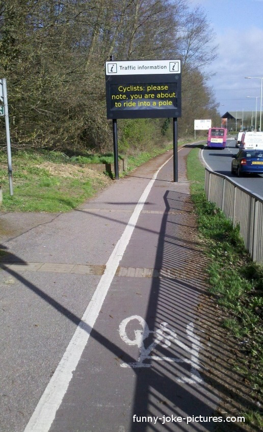 Funny Cyclist Hit Pole Sign Photo