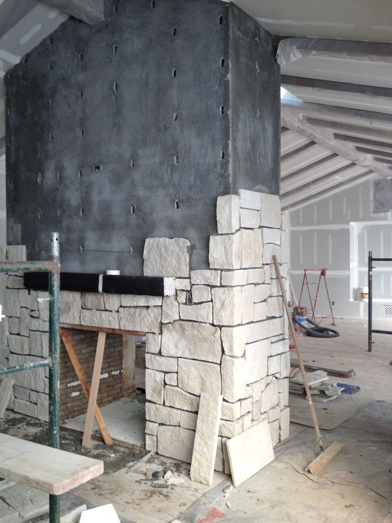 Limestone fireplace at #PatinaFarm in kitchen under construction