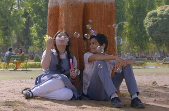 Zahira Wasim and Kabir Sajid in Secret Superstar, playing with soap bubbles