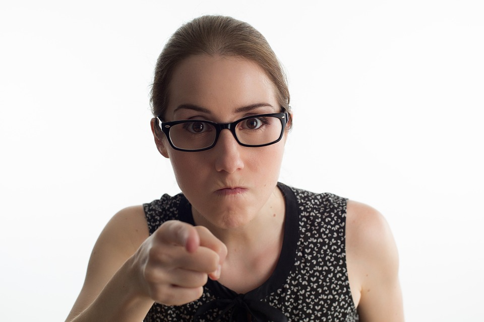 Angry woman pointing her finger to Illustrate Ways to Overcome Morning Rush That Only Ages You