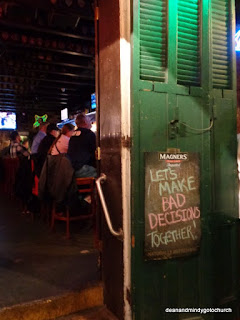 a sign at Boondock Saints and life on Bourbon Street