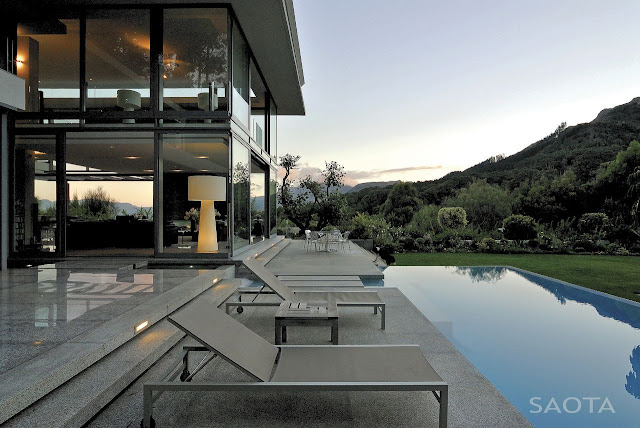 Picture of large modern terrace between the pool and the house