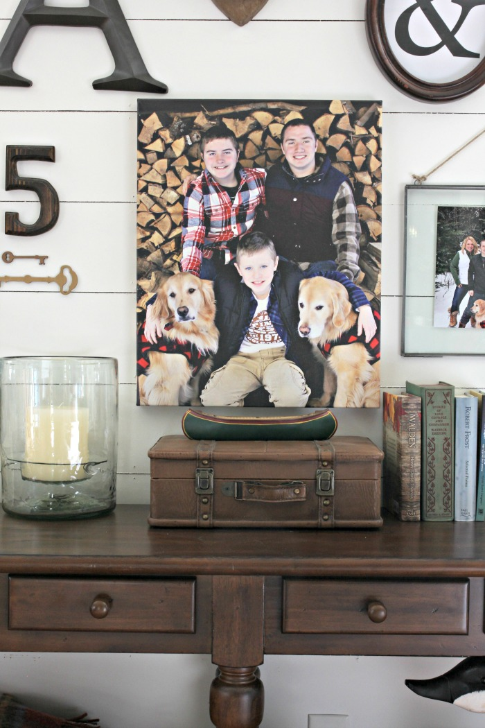 Photo canvas on planked gallery wall with Pottery Barn glass hurricane candle holder - www.goldenboysandme.com