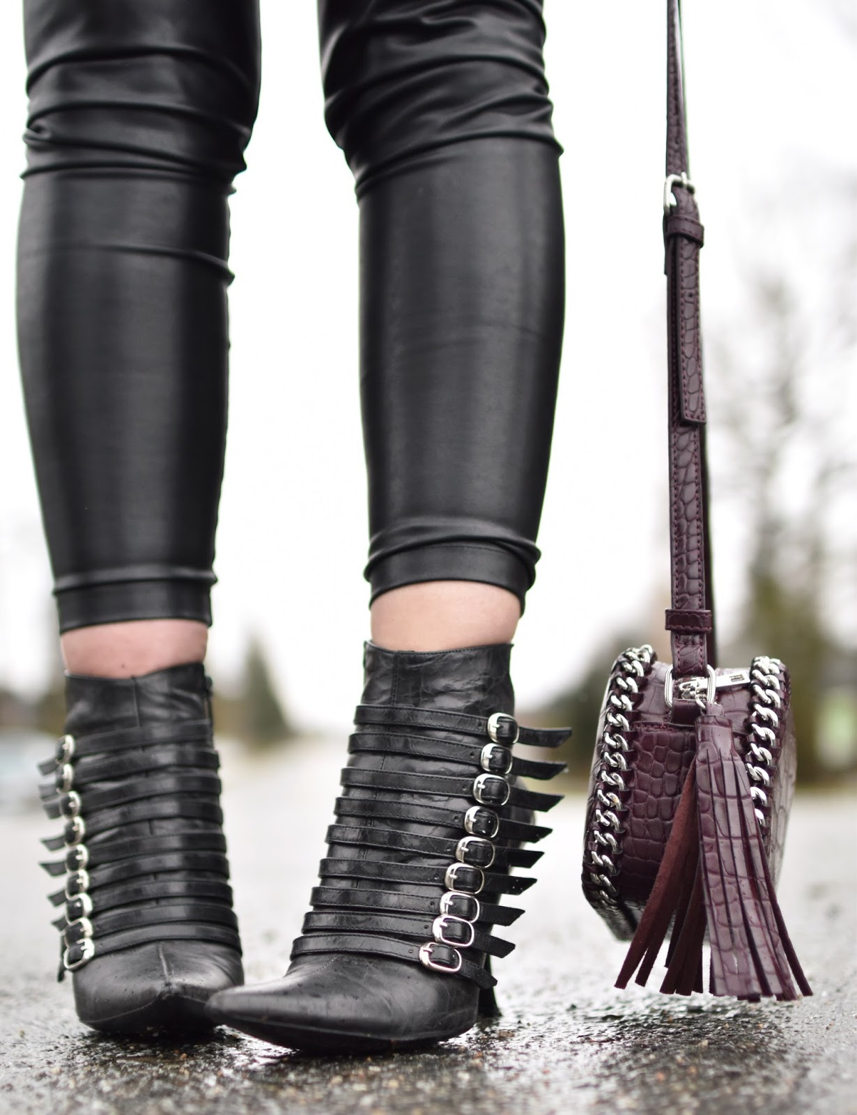 Monika Faulkner outfit inspiration - vegan leather leggings, buckle-embellished stiletto booties, maroon cross-body bag