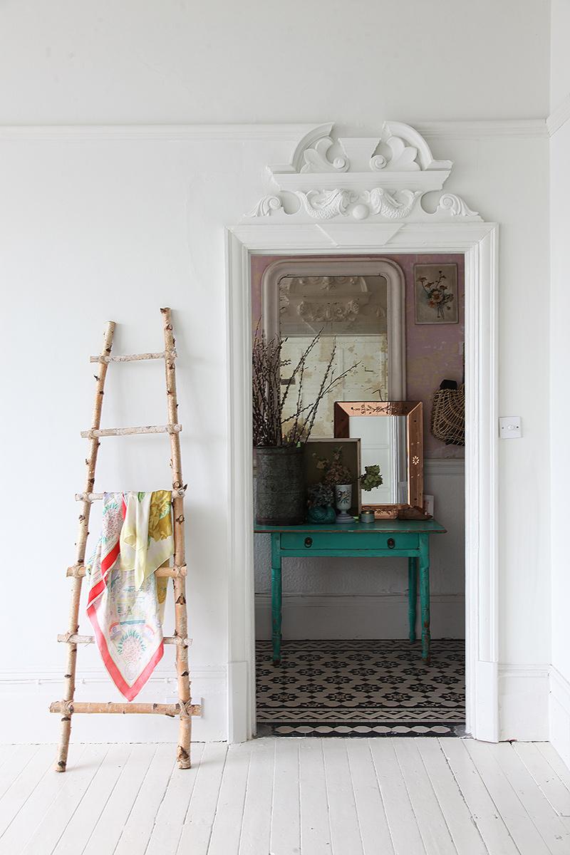 pattern floor tiles inside of a bohemian apartment, white painte floors