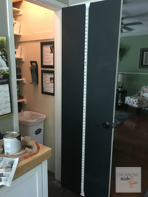 Chalkboard painted on back of door plus installing organizer :: OrganizingMadeFun.com