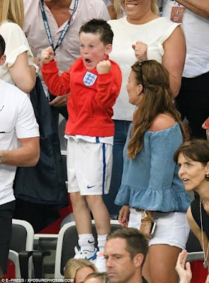 kai rooney celebrates as his father wayne scores a goal