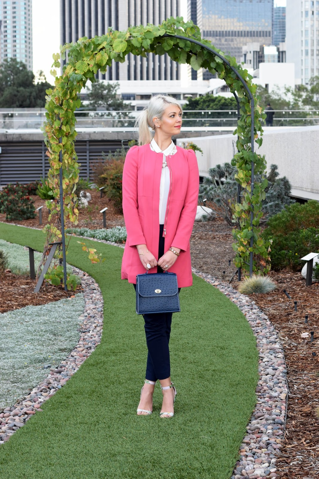 pink coat, ostrich purse, german blondy