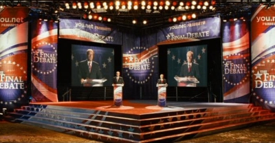 Kelsey Grammer and Dennis Hopper tailor their final presidential debate for the one voter who will cast the tie-breaking vote in SWING VOTE (2008), written by Joshua Michael Stern and Jason Richman.