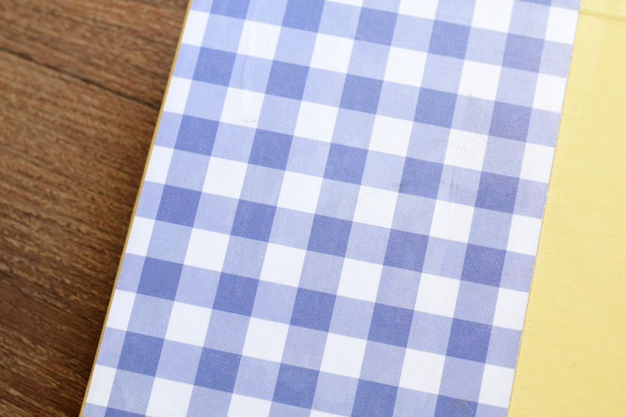 blue gingham scrapbook paper used to cover the inside of the album