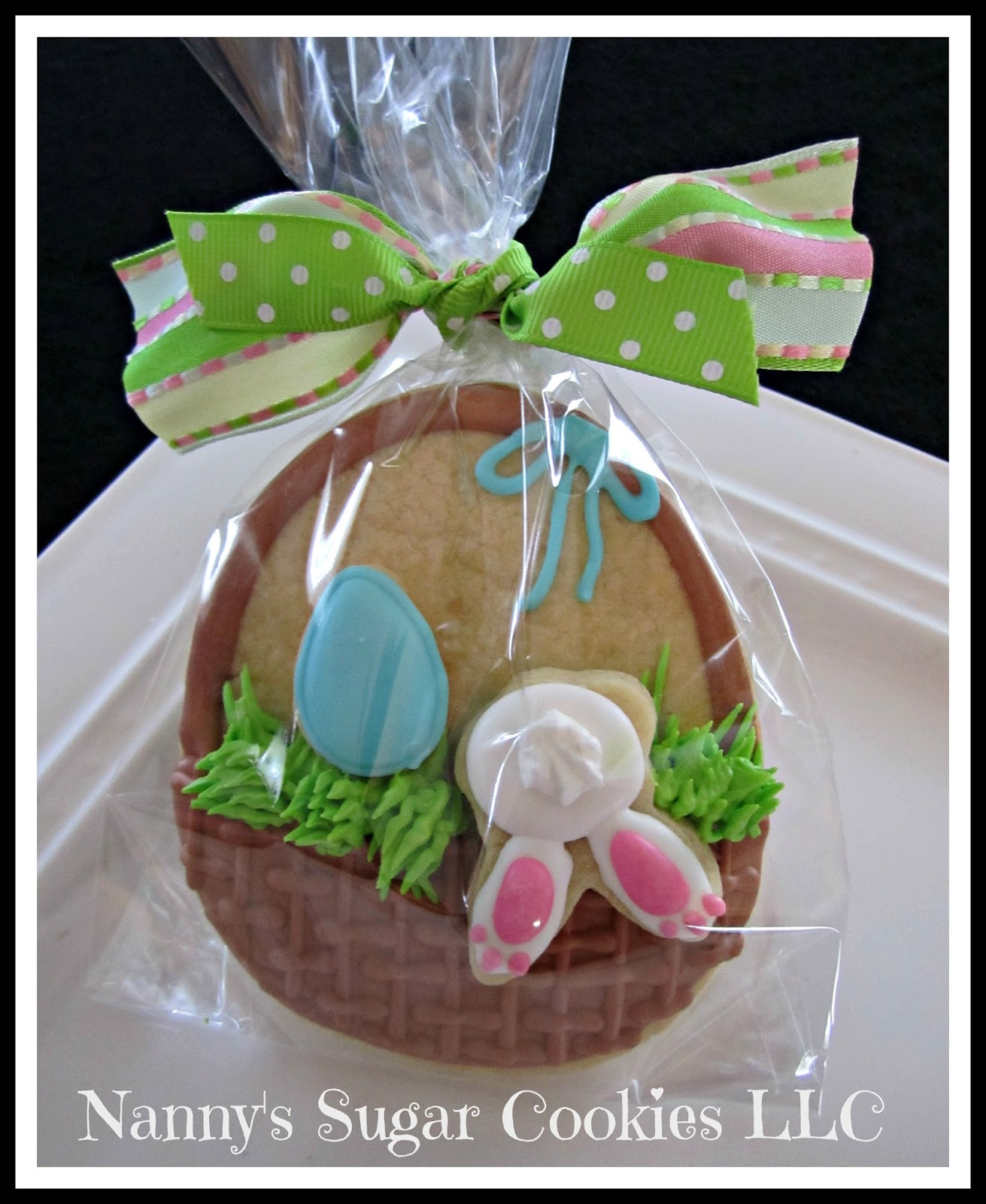 Nannys sugar cookies llc the easter bunny is coming to town bunny climbing into an easter basket negle Images