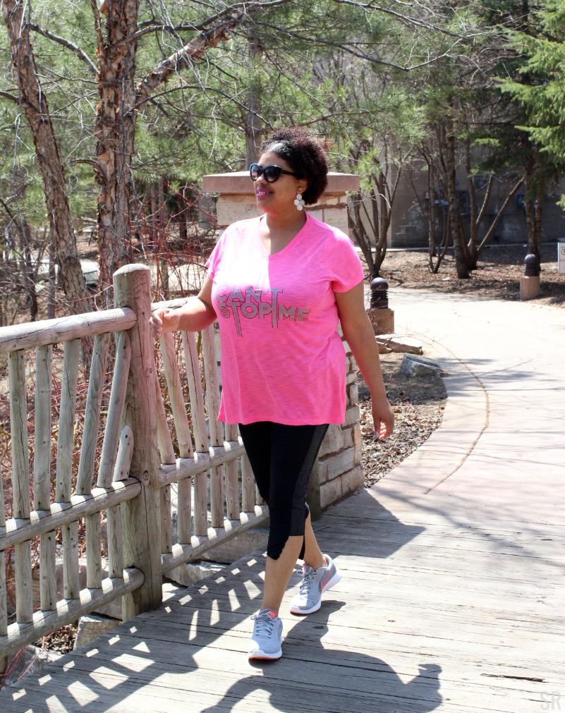 a woman walking on a bridge
