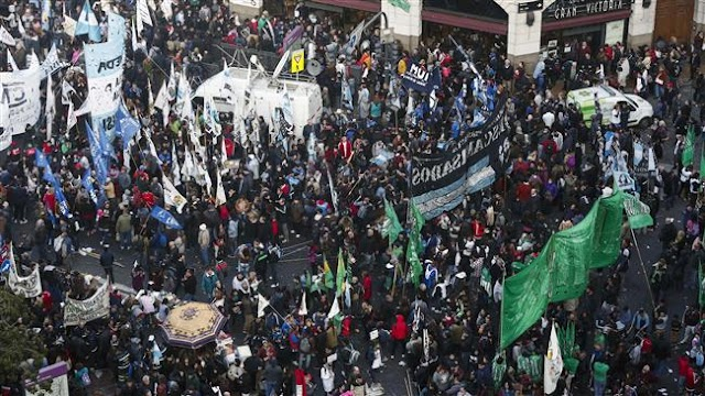 Tens of thousands of Argentinians in Buenos Aires protest President Mauricio Macri's economic reforms and state job cuts