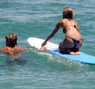 Jennifer Aniston hot beach bikini surfing photos