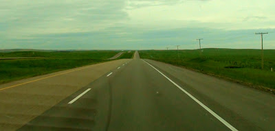 Wide open highway on the prairies