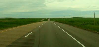 Wide open highway on the prairies