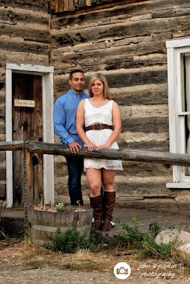 a couple poses for an engagement photography session in golden colorado