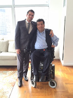 wheelchair rider jim sinocchi, with son james standing next to him,