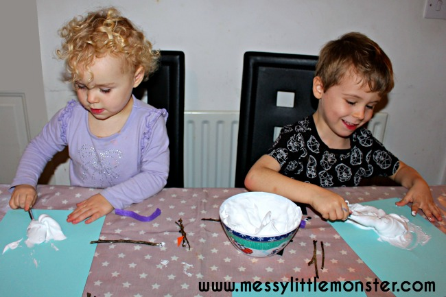 Puffy paint melted snowman kids craft. Winter themed activity idea.