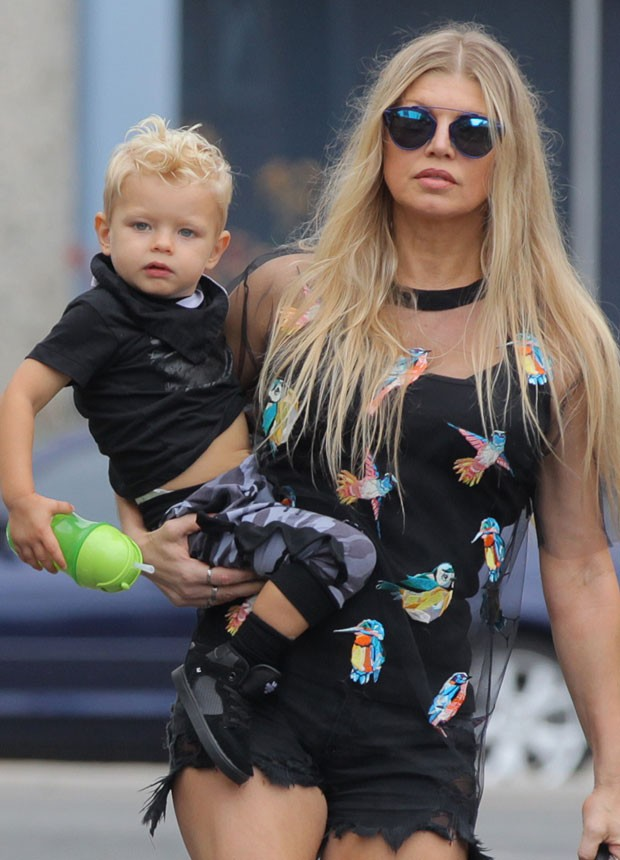 Fergie shows good form in short shorts ride with his son, Axl