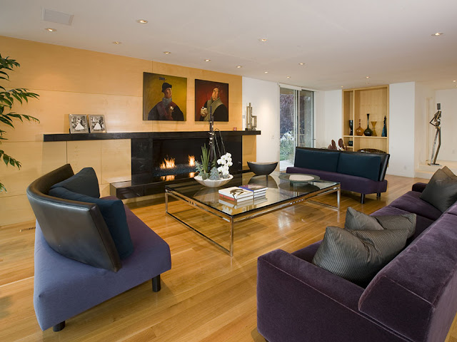 Picture of dark modern furniture by the fireplace and wooden wall in the living room