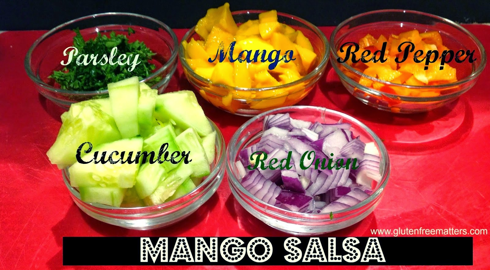 mango, parsley, red pepper, cucumber, red onion all cut in bowls