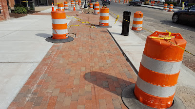 brick being laid on the sidewalks downtown