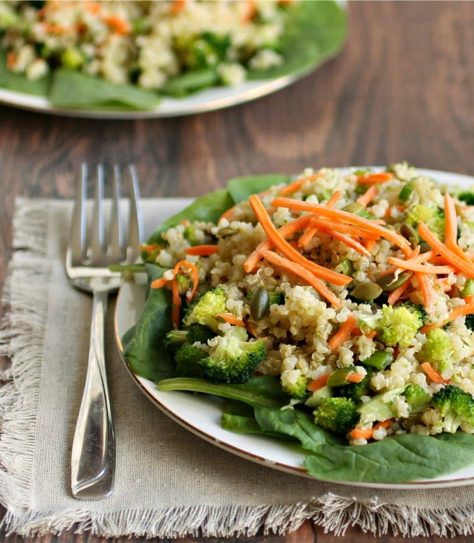Recipe for hearty salad made with quinoa, carrots, broccoli, sunflower seeds and tahini dressing.