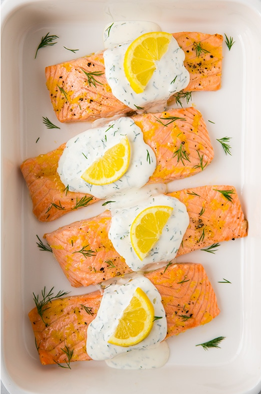 This Lemon Dill Salmon is topped with a creamy yogurt dill sauce that even my three-year-old loved! This easy salmon recipe comes together in 25 minutes and requires just a handful of ingredients.