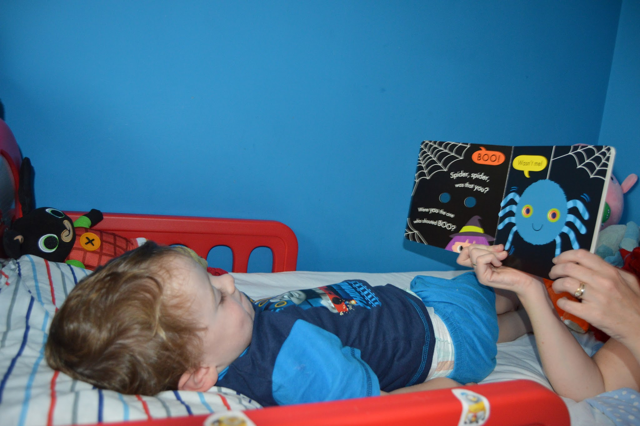 boy in bed reading a halloween story