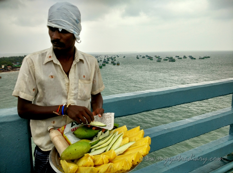 A guava seller on the Panbam Road Bridge, Rameshwaram