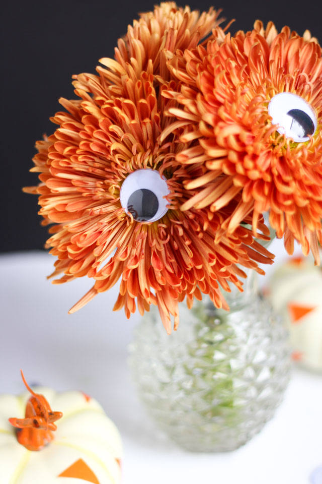 Add googly eyes to mums to make a spooky Halloween bouquet!