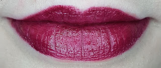 Avon mark. 3D Plumping Lipstick in Roasted Red lip swatch