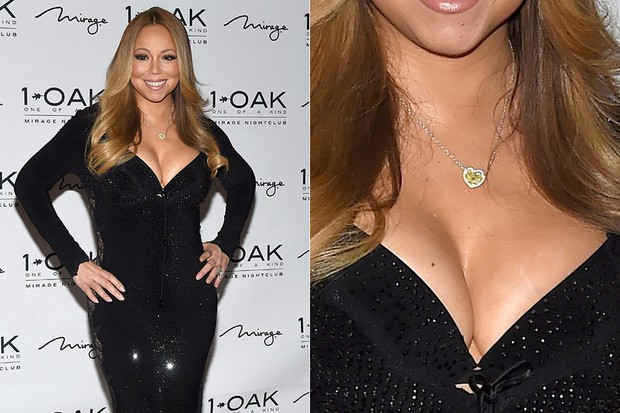 Mariah Carey dispenses lingerie in low-cut dress and with transparency