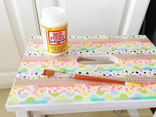 apply mod podge to seal washi tape on step stool