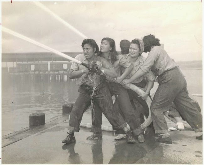 52 photos of women who changed history forever - Volunteers learn how to fight fires at Pearl Harbor [c. 1941 - 1945]