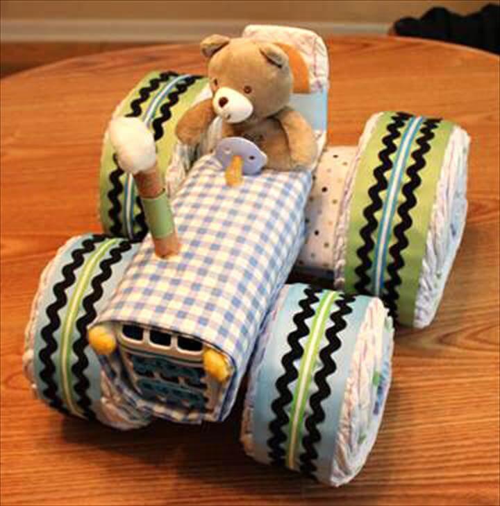 bolo de fraldas-bolo de cha de bebe-bolo fralda-modelos de fraldas-ideia de cha de bebe-decoracao cha de bebe-bolos decorados cha- fralda-cha de bebe-pacote de fralda-gravidez-gestação-maternidade-recem-nascido-bebê recém nascido-baby diaper cake-baby diaper diaper-enxoval de bebe