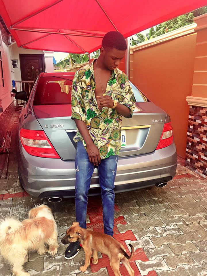 Blogger Clement Ogudu poses with his cute puppies