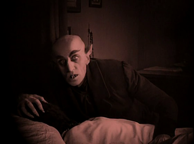 Count Orlok Rises After Sucking Ellen Hutter's Blood all night long, Max Schreck, Directed by F. W. Murnau