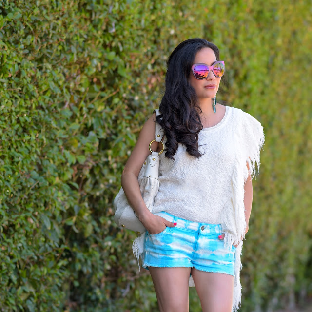 Car Mar Blue Tie Dye Denim Chloe Tan Leather Wedge Car Mar Tie Dye Blue Denim Shorts Christian Dior Cat Eye Pink Mirror Glasses Robert Lee Morris Blue and Green Leaf Earrings Free People Cream Fringe Tunic