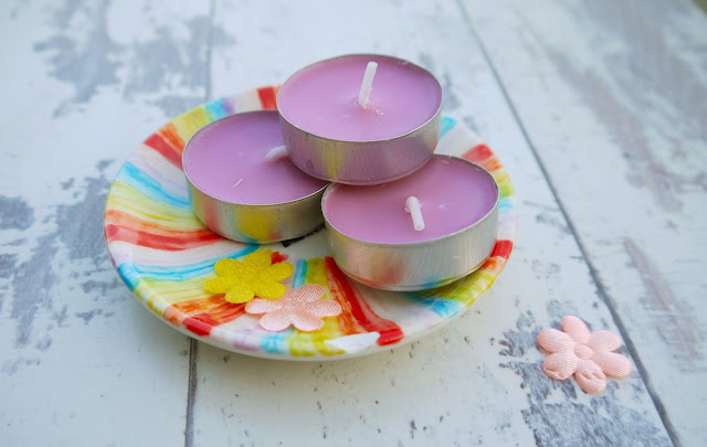 3 primark tealights stacked on rainbow striped plate